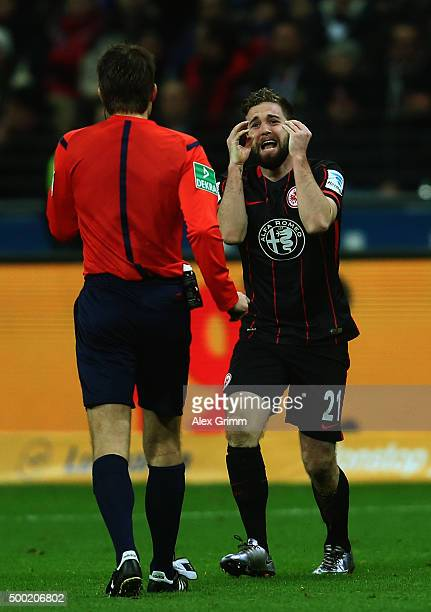 Marc Stendera of Frankfurt discusses with referee Felix Brych during the Bundesliga match between Eintracht Frankfurt and SV Darmstadt 98 at...