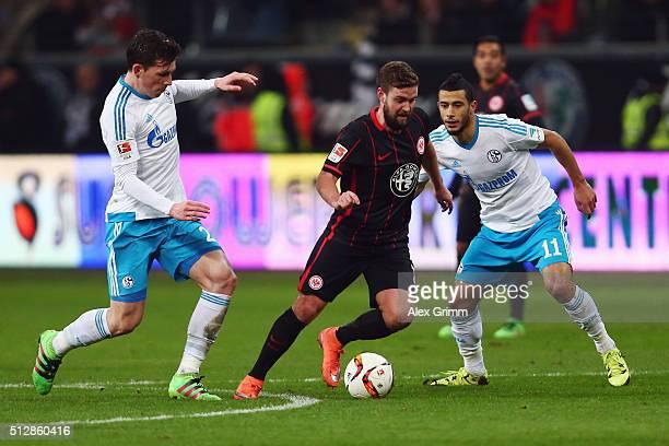 Marc Stendera of Frankfurt is challenged by PierreEmile Hojbjerg and Younes Belhanda of Schalke during the Bundesliga match between Eintracht...
