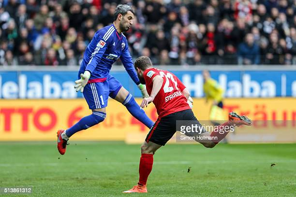 Marc Stendera of Frankfurt tries to score against goalkeeper Ramazan Oezcan of Ingolstadt during the Bundesliga match between Eintracht Frankfurt and...