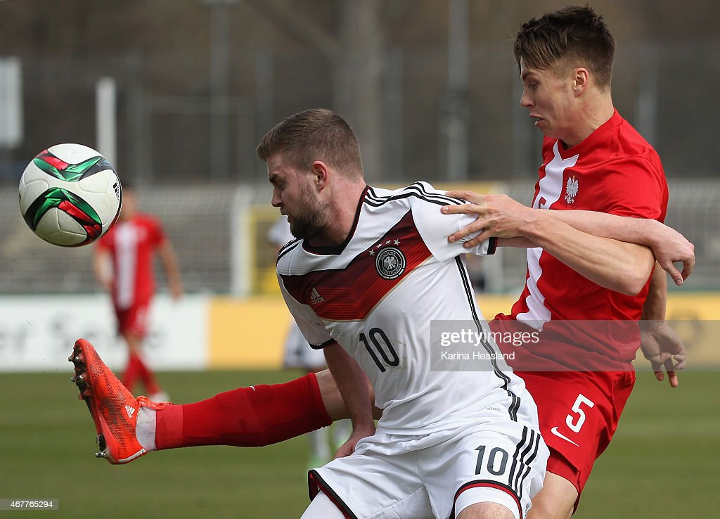 Marc Stendera of Germany is challenged by Igor Lasicki of Poland during the International Friendly match between U20 Germany and U20 Poland at...