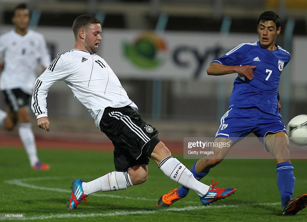 Marc Stendera (l) of Germany is challenged by Lozidi Panagiotis of Cyprus during the international friendly match between U18 Cyprus and U18 Germany at Stadio Tasos Markou on February 5, 2013 in Paralimni, Cyprus.