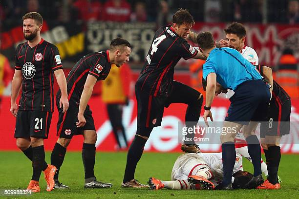 Marc Stendera Yanni Regaesel and Marco Russ of Frankfurt argue with Anthony Modeste Filip Mladenovic of Koeln and referee Felix Zwayer during the...