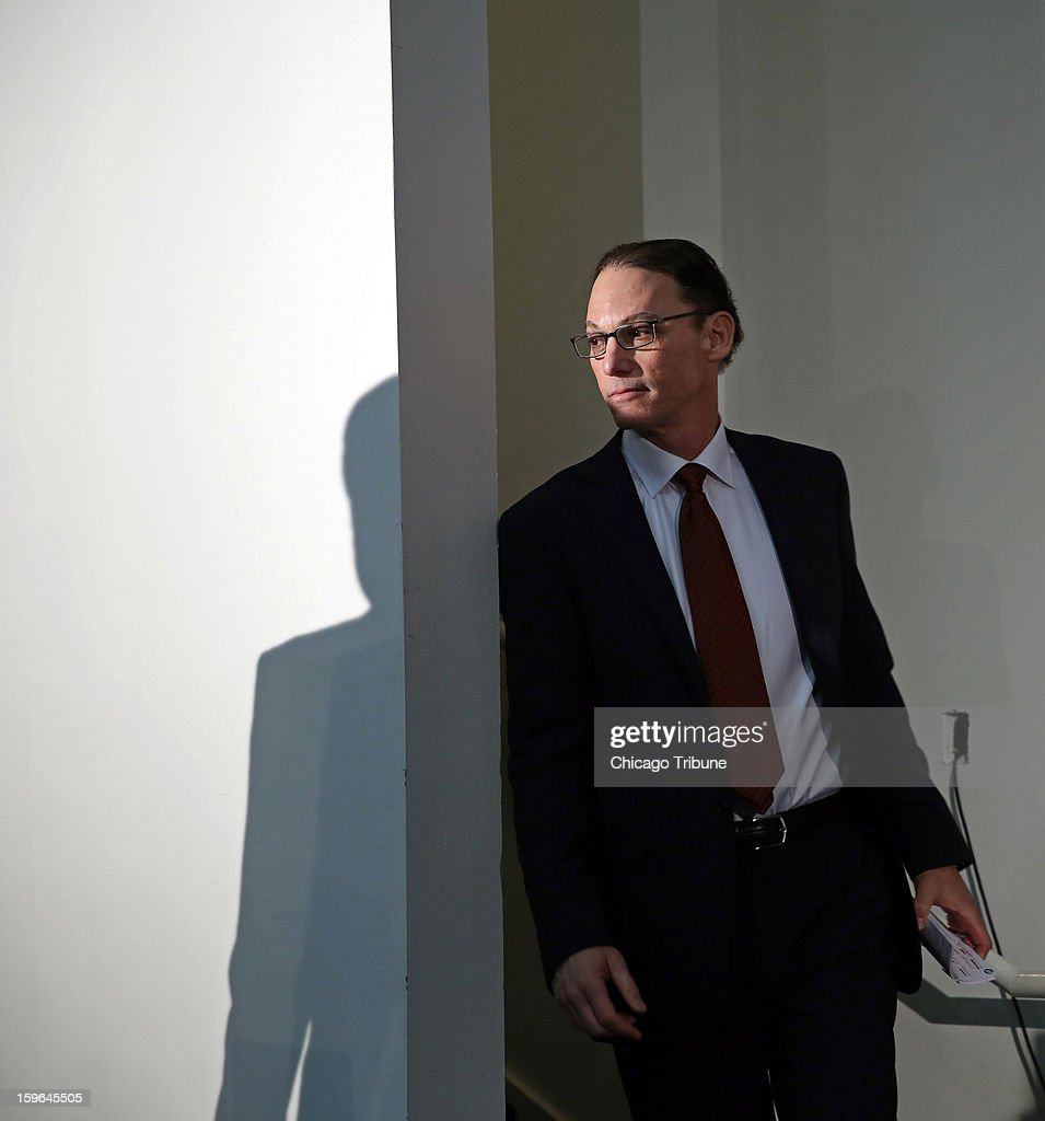 Marc Trestman enters the auditorium to be announced as head coach of the Chicago Bears at Halas Hall in Lake Forest, Illinois, on Thursday, January 17, 2013.