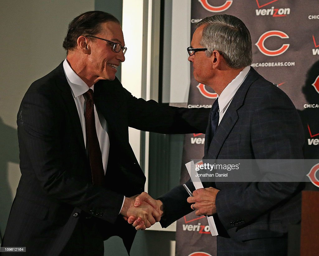 Marc Trestman (L) shakes hands with General Manager Phil Emery before being introducted as the new head coach of the Chicago Bears at Halas Hall on January 17, 2013 in Lake Forest, Illinois.