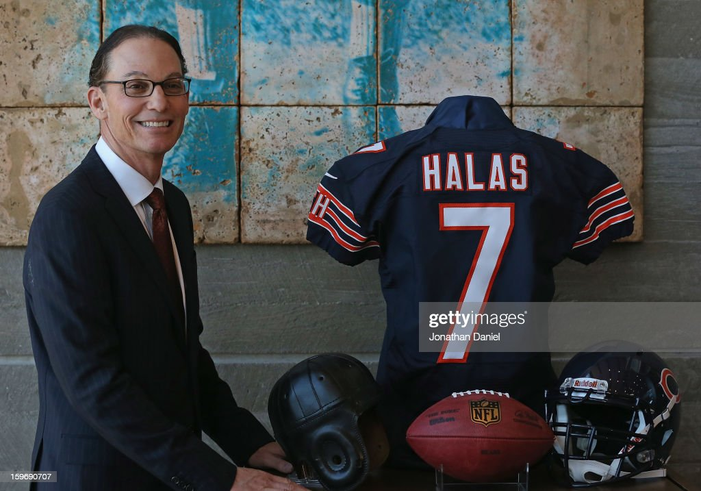 Marc Trestman, the new head coach of the Chicago Bears, poses with a George Halas jersey following an introductory press conference at Halas Hall on January 17, 2013 in Lake Forest, Illinois.