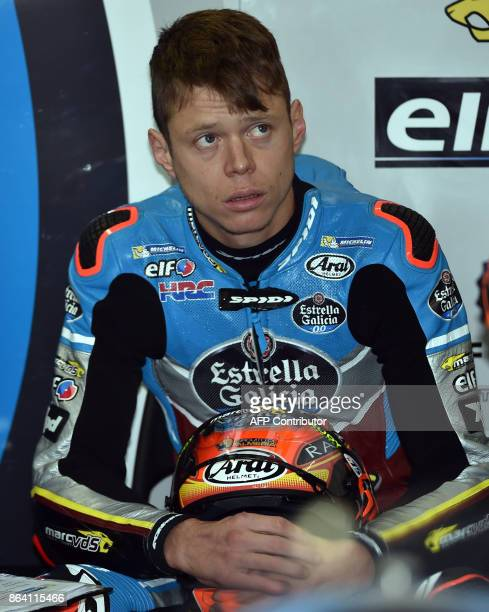 Marc VDS Honda rider Tito Rabat of Spain listens to a team member during the third practice session of the Australian MotoGP Grand Prix at Phillip...