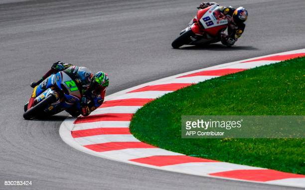 Marc VDS's Italian rider Franco Morbidelli and IDEMITSU Honda Team Malaysian rider Khairul Idham Pawi compete during first practice session of the...