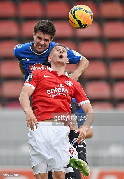 Marc Wachs of Mainz and Florian Dick of Bielefeld head for the ball during the Third League match between FSV Mainz 05 II and Arminia Bielefeld at...
