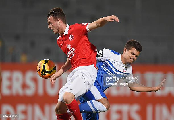 Marc Wachs of Mainz and Julian Jakobs of Rostock compete for the ball during the Third league match between 1 FSV Mainz 05 II and Hansa Rostock at...