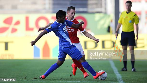 Marc Wachs of Mainz is challenged by Ahmed Waseem Razeek of Magdeburg during the 3 Liga match between 1 FSV Mainz 05 II and 1 FC Magdeburg at...