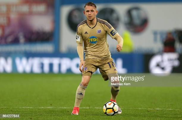 Marc Wachs of Osnabrueck runs with the ball during the third league match between FC Hansa Rostock and VfL Osnabrueck at Ostseestadion on October 20...