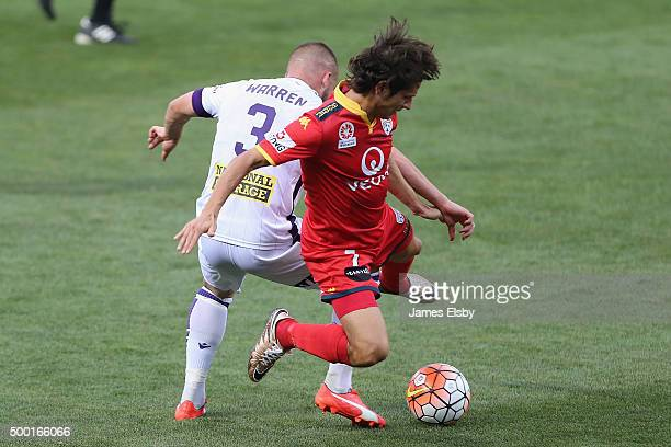 Marc Warren of Perth tackles Pablo Sanchez of Adelaide during the round nine ALeague match between Adelaide United and Perth Glory at Coopers Stadium...