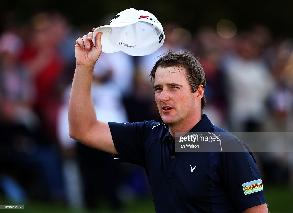 Marc Warren of Scotland acknowledges the applause on the eighteenth green after losing a play-off during the final round of the BMW PGA Championship on the West Course at Wentworth on May 26, 2013 in Virginia Water, England.