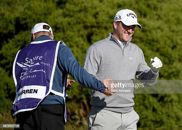 Marc Warren of Scotland celebrates after winning on the first extra hole during his match against Tyrrell Hatton of England in the Quater Final of...
