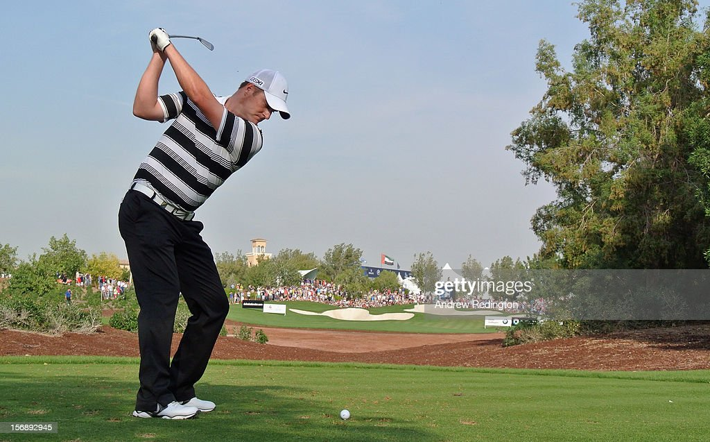 Marc Warren of Scotland hits his tee-shot on the 13th hole during the third round of the DP World Tour Championship on the Earth Course at Jumeirah Golf Estates on November 24, 2012 in Dubai, United Arab Emirates.
