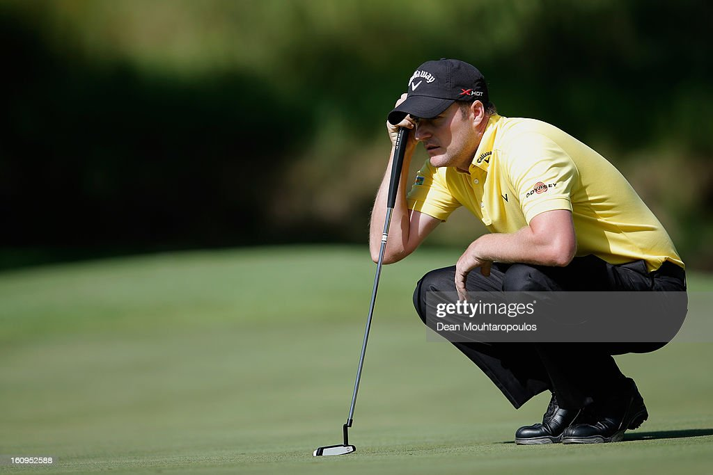 Marc Warren of Scotland lines up his putt on the 5th green during Day Two of the Joburg Open at Royal Johannesburg and Kensington Golf Club on February 8, 2013 in Johannesburg, South Africa.