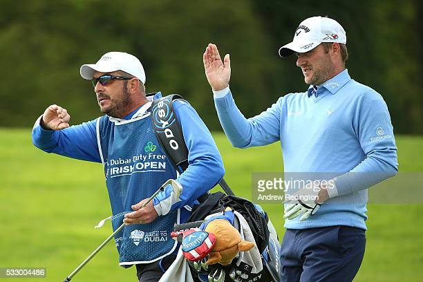 Marc Warren of Scotland lines up with his caddie Ken Herring on the 18th hole during the second round of the Dubai Duty Free Irish Open Hosted by the...