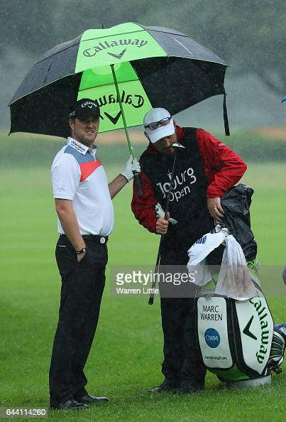 Marc Warren of Scotland looks on as the rain falls during the first round of the Joburg Open at Royal Johannesburg and Kensington Golf Club on...