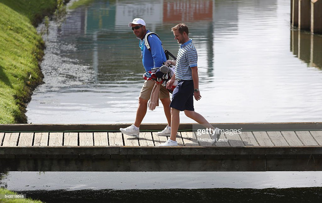 <a gi-track='captionPersonalityLinkClicked' href=/galleries/search?phrase=Marc+Warren+-+Golfer&family=editorial&specificpeople=12333476 ng-click='$event.stopPropagation()'>Marc Warren</a> of Scotland looks on with his caddie Ken Herring during a practice round ahead of the 100th Open de France at Le Golf National on June 29, 2016 in Paris, France.