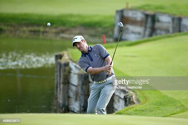 Marc Warren of Scotland pitches onto the 9th green during the first round of the 2014 Turkish Airlines Open at The Montgomerie Maxx Royal on November...