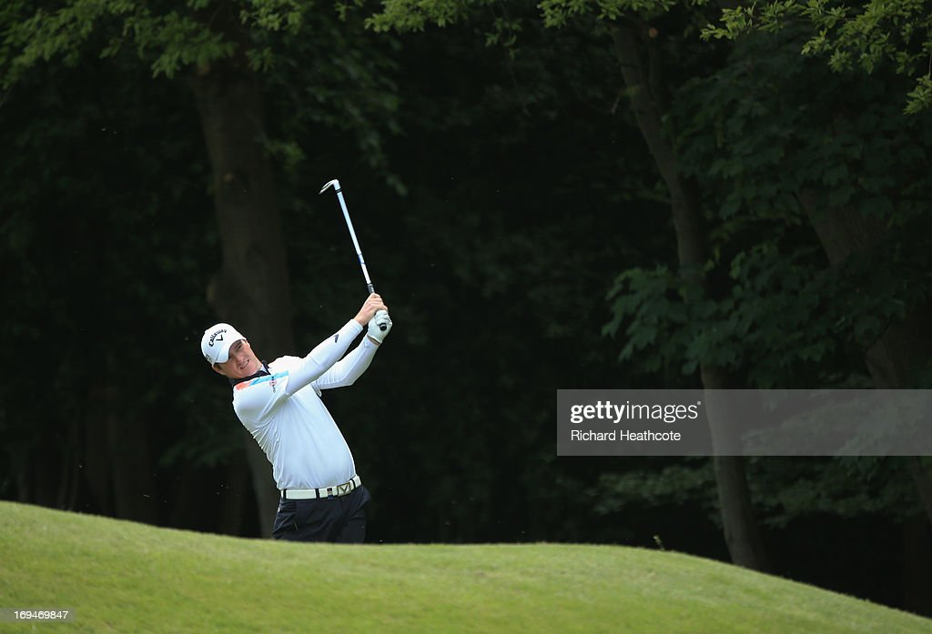 Marc Warren of Scotland plays an approach to the sixteenth hole during the third round of the BMW PGA Championship on the West Course at Wentworth on May 25, 2013 in Virginia Water, England.
