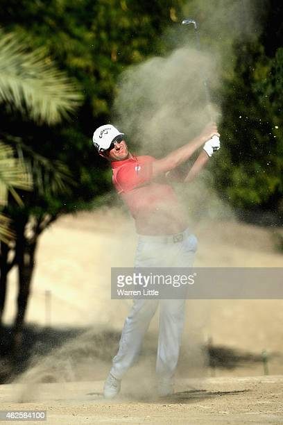Marc Warren of Scotland plays his second shot into the 14th green during the third round of the Omega Dubai Desert Classic on the Majlis Course at...
