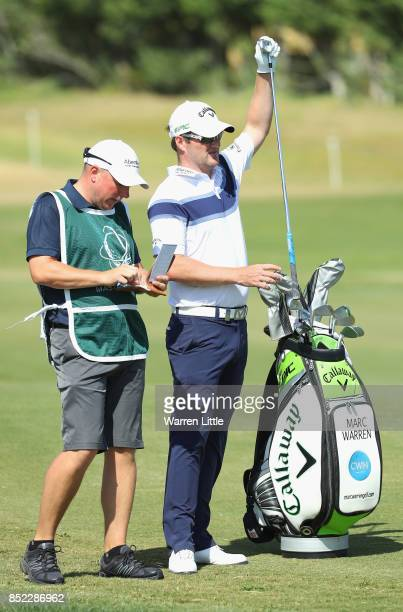 Marc Warren of Scotland plays his second shot into the ninth green during the Portugal Masters at the Oceanico Victoria Golf Club on September 23...
