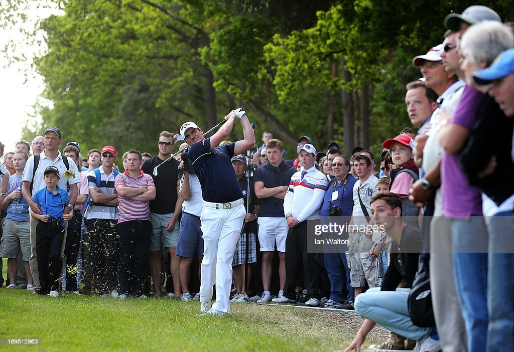 Marc Warren of Scotland plays his second shot on the fifteenth hole during the final round of the BMW PGA Championship on the West Course at Wentworth on May 26, 2013 in Virginia Water, England.