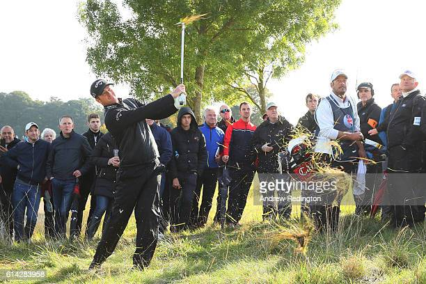 Marc Warren of Scotland plays his second shot on the ninth hole during the first round of the British Masters at The Grove on October 13 2016 in...