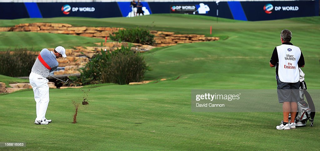 Marc Warren of Scotland plays his third shot on the par five 18th hole during the first round of the 2012 DP World Tour Championship on the Earth Course at Jumeirah Golf Estates on November 22, 2012 in Dubai, United Arab Emirates.