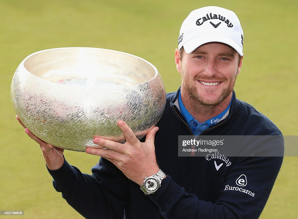 Marc Warren of Scotland poses with the trophy after winning Made In Denmark at Himmerland Golf & Spa Resort on August 17, 2014 in Aalborg, Denmark.