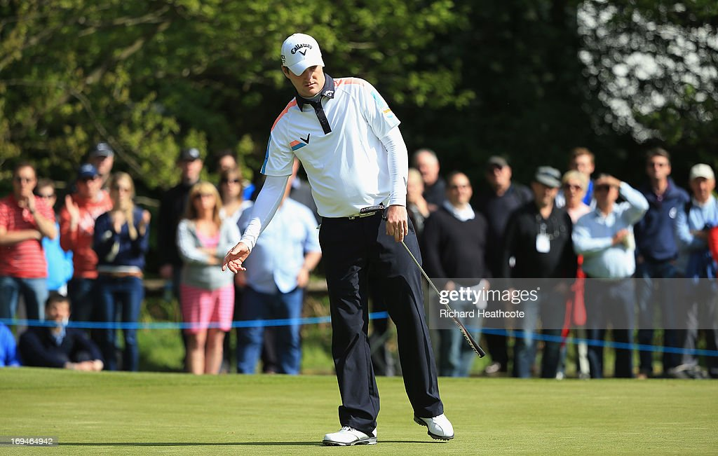 Marc Warren of Scotland reacts to a missed putt on the fifteenth green during the third round of the BMW PGA Championship on the West Course at Wentworth on May 25, 2013 in Virginia Water, England.