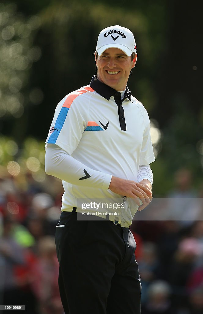 Marc Warren of Scotland smiles during the third round of the BMW PGA Championship on the West Course at Wentworth on May 25, 2013 in Virginia Water, England.