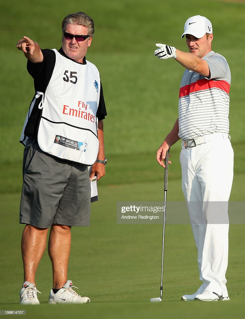 Marc Warren of Scotland talks with his caddie Gary Edwards on the second hole during the first round of the DP World Tour Championship on the Earth Course at Jumeirah Golf Estates on November 22, 2012 in Dubai, United Arab Emirates.
