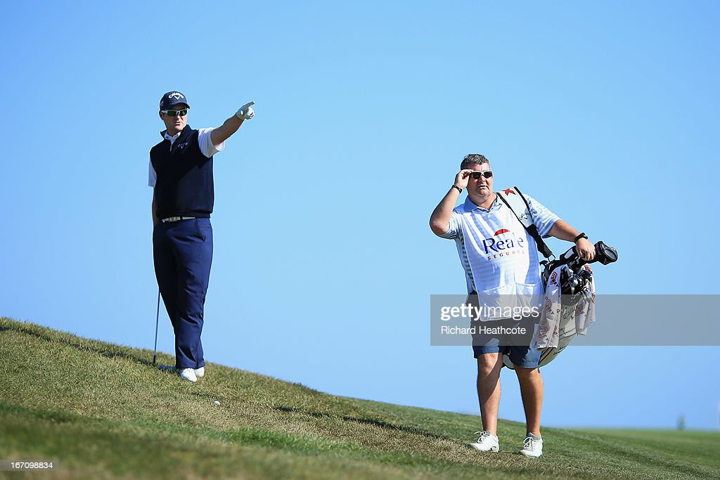 Marc Warren of Scotland talks with his caddy on the 18th fairway during the Third round of the Open de Espana at Parador de El Saler on April 20, 2013 in Valencia, Spain