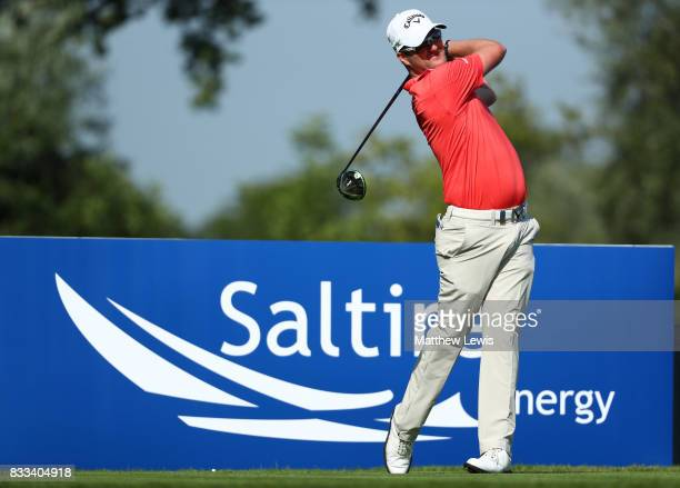 Marc Warren of Scotland tees off on the 3rd hole during round one of the Saltire Energy Paul Lawrie Matchplay at Golf Resort Bad Griesbach on August...