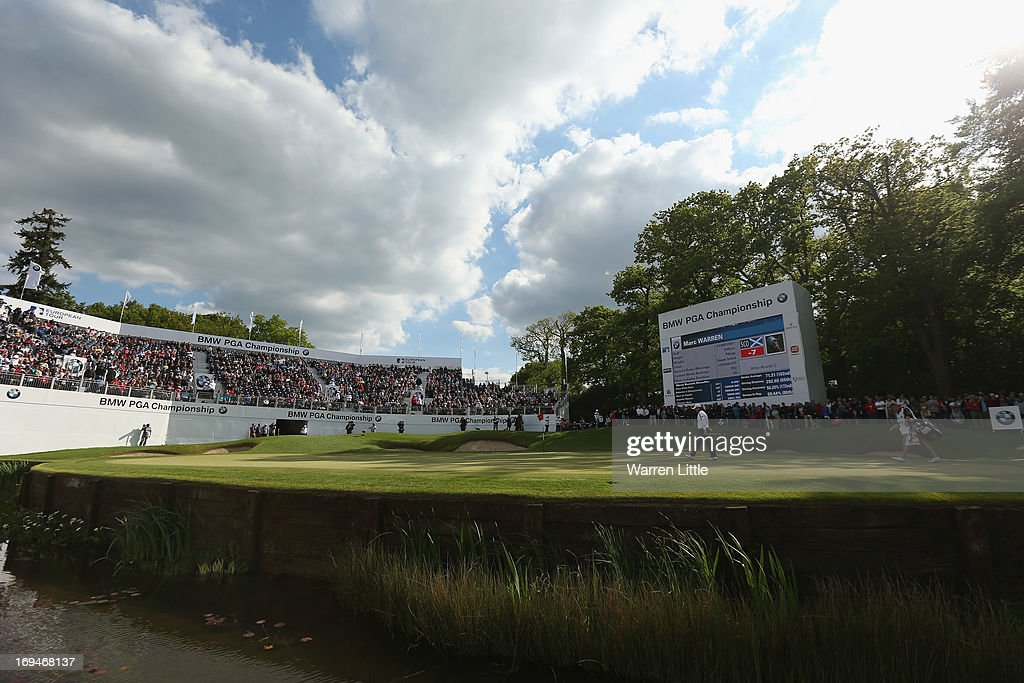 Marc Warren of Scotland walks onto the 18th green during the third round of the BMW PGA Championship on the West Course at Wentworth on May 25, 2013 in Virginia Water, England.
