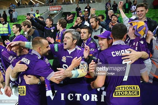 Marc Warren of the Glory and Joel Chianese of the Glory celebrate the win with fans during the round three ALeague match between Melbourne City FC...