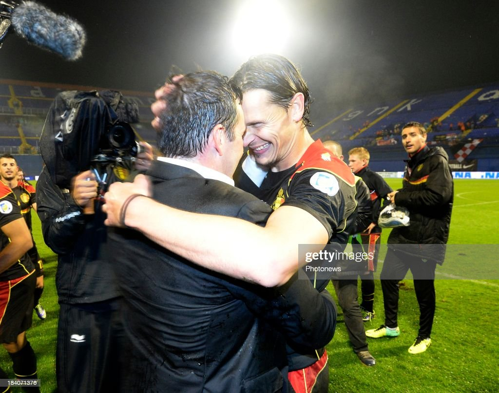 <a gi-track='captionPersonalityLinkClicked' href=/galleries/search?phrase=Marc+Wilmots&family=editorial&specificpeople=1016207 ng-click='$event.stopPropagation()'>Marc Wilmots</a>, headcoach of Belgium Daniel Van Buyten of Belgium celebrate the win and qualification for Worldcup 2014 during the World Cup 2014 Qualification match between Croatia and Belgium on October 11, 2013 in Zagreb, Croatia.