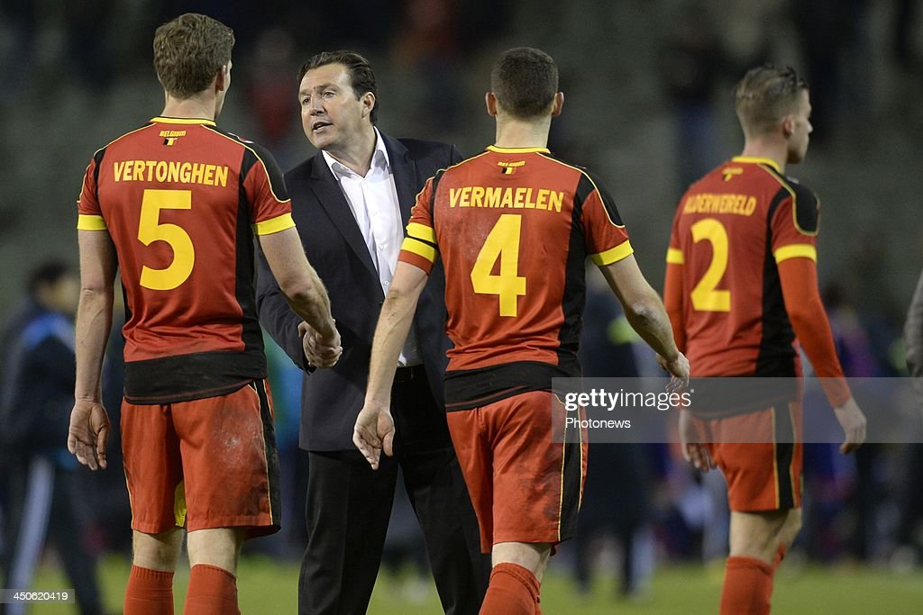 Marc Wilmots, headcoach of Belgium shakes hands with Jan Vertonghen of Belgium during the international friendly match before the World Cup in Brasil between Belgium and Japan on November 19, 2013 in Brussels, Belgium