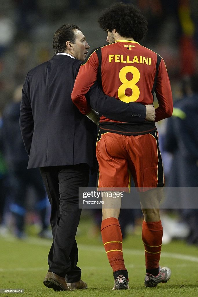 Marc Wilmots, headcoach of Belgium talks to Marouane Fellaini of Belgium during the international friendly match before the World Cup in Brasil between Belgium and Japan on November 19, 2013 in Brussels, Belgium