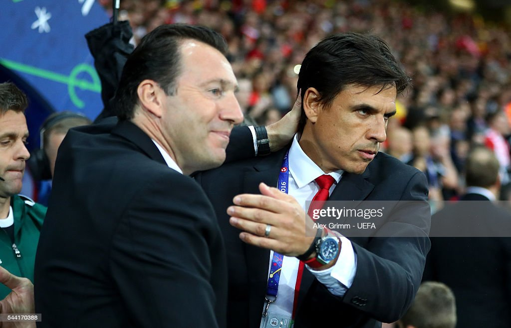 Marc Wilmots manager of Belgium and Chris Coleman manager of Wales greet prior to the UEFA EURO 2016 quarter final match between Wales and Belgium at Stade Pierre-Mauroy on July 1, 2016 in Lille, France.