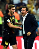 Marc Wilmots of Belgium celebrates his team's first goal with Nicolas Lombaerts during the 2014 FIFA World Cup Brazil Group H match between Korea...