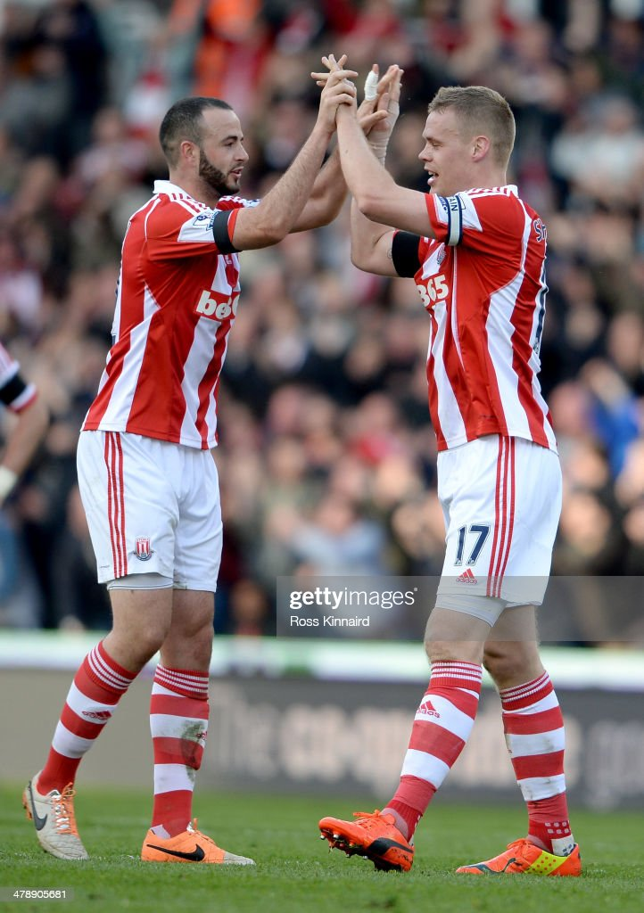 Marc Wilson of Stoke and Ryan Shawcross of Stoke celebrate during the Barclays Premier League match between Stoke City and West Ham United at the Britannia Stadium on March 15, 2014 in Stoke on Trent, England.