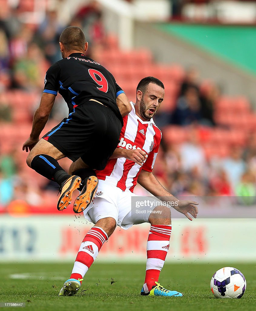 Marc Wilson of Stoke challenges Kevin Phillips of Crystal Palace during the Barclays Premier League match between Stoke City and Crystal Palace at Britannia Stadium on August 24, 2013 in Stoke on Trent, England.