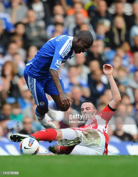 Marc Wilson of Stoke City challenges Ramires of Chelsea during the Barclays Premier League match between Chelsea and Stoke City at Stamford Bridge on...