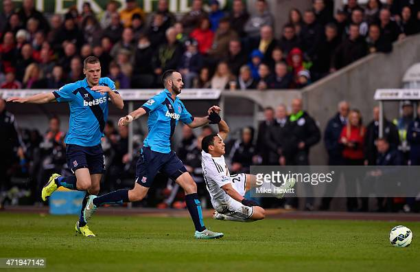 Marc Wilson of Stoke City fouls Jefferson Montero of Swansea City leading to his sending off during the Barclays Premier League match between Swansea...
