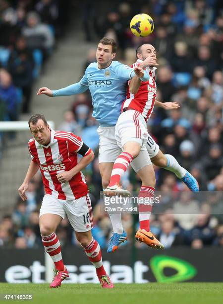 Marc Wilson of Stoke City in action with Edin Dzeko of Manchester City during the Barclays Premier League match between Manchester City and Stoke...