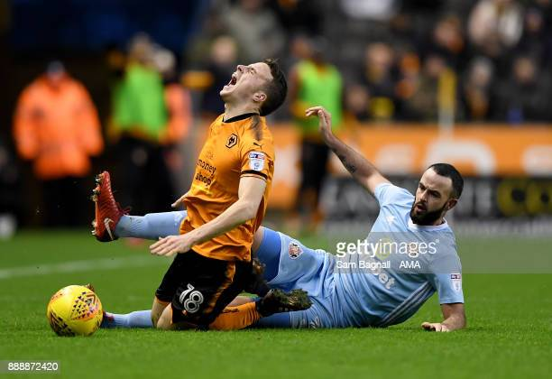 Marc Wilson of Sunderland and Diogo Jota of Wolverhampton Wanderers during the Sky Bet Championship match between Wolverhampton and Sunderland at...