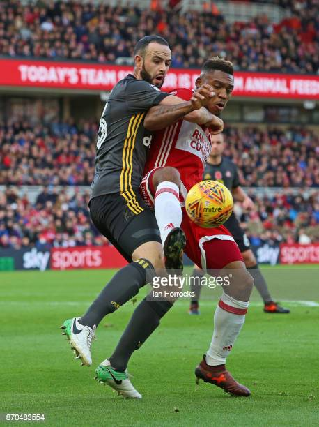 Marc Wilson of Sunderland tries to challenge Britt Assombalonga of Middlesbrough during the Sky Bet Championship match between Middlesbrough and...